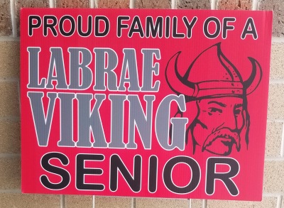"Yard sign which says ""Proud family of a LaBrae Viking senior."""